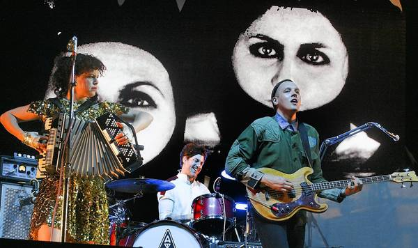 "Arcade Fire, shown here performing at Coachella in 2011, goes to new heights with its ""Reflektor"" album."