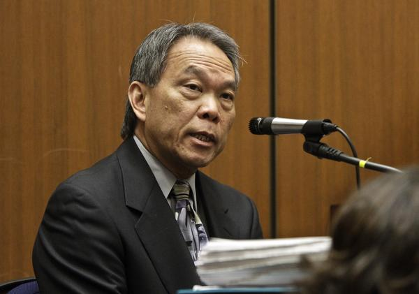 Former Bell city attorney Edward Lee testifies during a 2011 hearing.