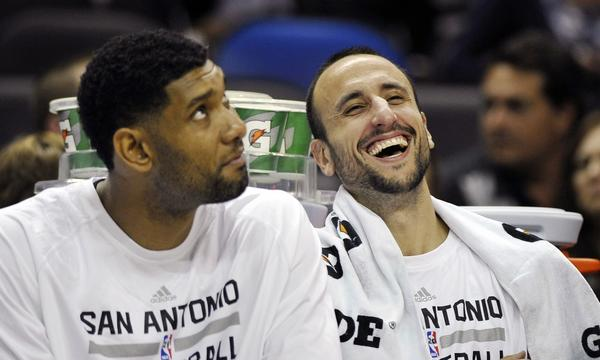 San Antonio Spurs teammates Tim Duncan, left, and Manu Ginobili share a light-hearted moment on the bench during a preseason game on Oct. 13.
