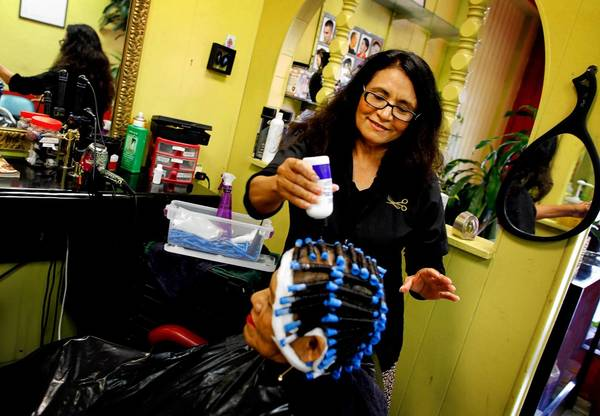 Maria Garcia, who is active in her church at Dolores Mission, has a captive audience at her Boyle Heights hair salon - and she's using it to spread the word about the new federal healthcare law.