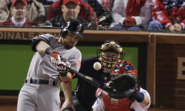 Boston's Jacoby Ellsbury hits a run-scoring single during the seventh inning of a 3-1 win over St. Louis in Game 5 of the World Series on Monday.