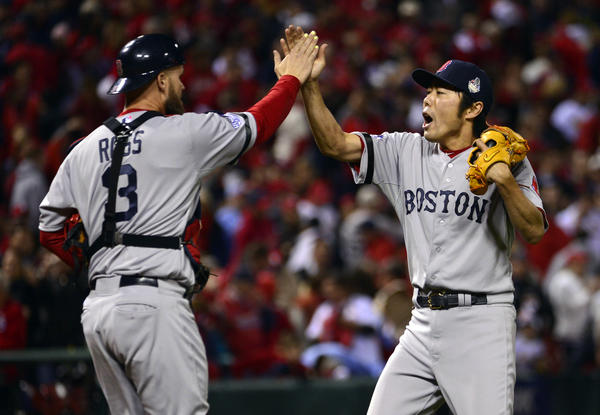 Red Sox closer Koji Uehara (right) celebrates with catcher David Ross (3) after winning Game 5.