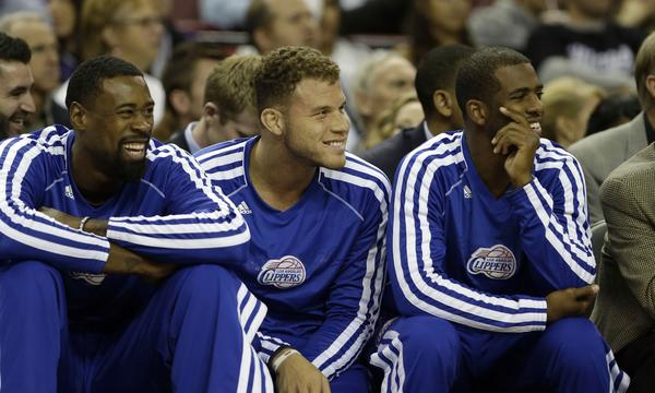 Clippers DeAndre Jordan, left, Blake Griffin, center, and Chris Paul watch their team play against the Sacramento Kings.