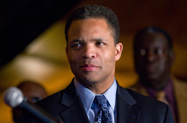 U.S. Representative Jesse Jackson Jr. stands with a group of about 50 ministers and other religious leaders voicing support for his re-election campaign during an event at the Park 52 restaurant in February.