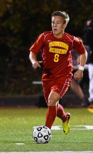 Moravian Academy's Ryan Brown (8) dribbles the ball against Northwestern Lehigh during a Colonial League boys soccer final held at Salisbury High School on Wednesday, Oct. 16, 2013.