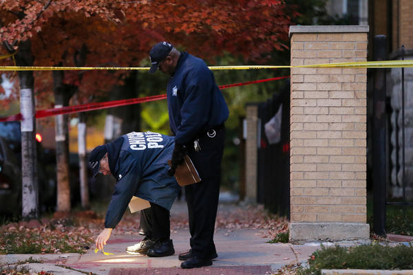 Police work the scene where a 23-year-old man was fatally shot in the early morning hours of Tuesday near the intersection of West Wrightwood Avenue and North Sawyer Avenue in the Logan Square neighborhood of Chicago.
