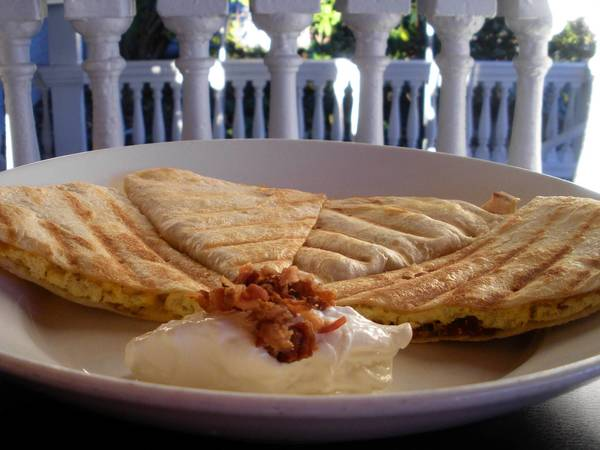 Breakfast quesadillas made with eggs, cheese and bacon are quick and easy.