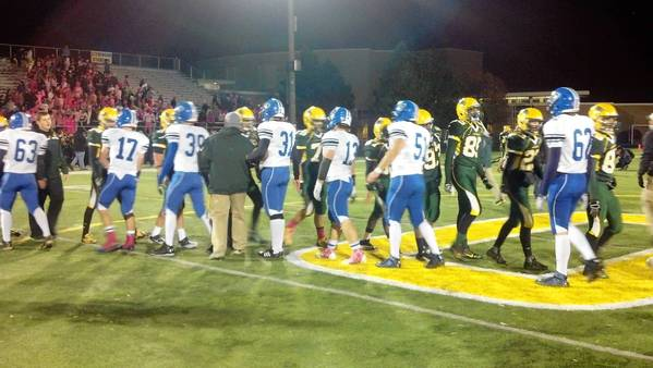Lake Zurich and Stevenson players exchange handshakes after Friday's game.