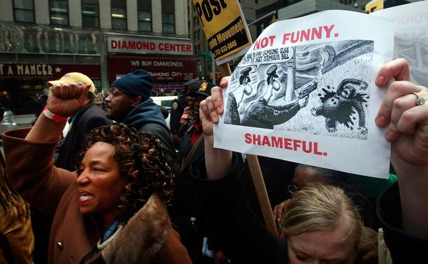 Hundreds of demonstrators gather outside New York Post headquarters to protest a controversial chimpanzee cartoon in the newspaper February 19, 2009 in New York City. Protesters say the cartoon in the tabloid is racist and links President Barack Obama with a violent chimpanzee shot dead by police.