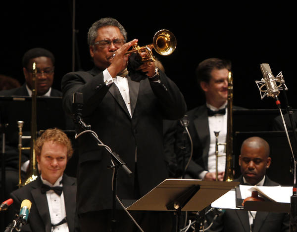 Jon Faddis plays trumpet with the Chicago Jazz Ensemble.