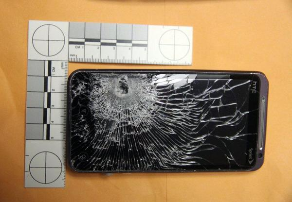 A cellphone carried by a Florida gas station clerk stopped a bullet fired at him during a robbery attempt in the Orlando suburb of Winter Garden.