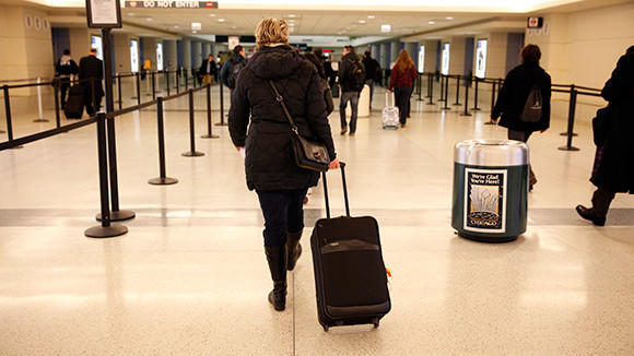 A passenger walks to the security gate to enter the terminal at Chicago's Midway Airport on Thursday, Feb. 21, 2013.