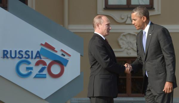 "Russian President Vladimir Putin welcomes President Obama to St. Petersburg in September in a brief encounter ahead of the G20 summit. Two Italian newspapers reported Tuesday that the Russian hosts included ""Trojan horse"" data surveillance devices in the gift bags given to all G20 summit delegates."
