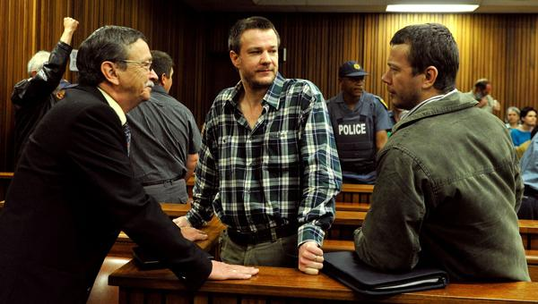 Johan and Wilhelm Pretorius, center and right, two of the South African extremists convicted of treason for a plot to kill former President Nelson Mandela and drive blacks out of the country, attend their trial at Pretoria High Court on Tuesday.