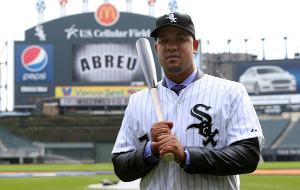 Cuban slugger Jose Abreu, 26, poses for photos at U.S. Cellular Field on Tuesday. The White Sox have agreed to terms on a six-year, $68-million contract with the free agent.