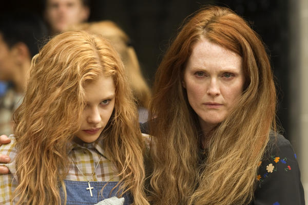 "Chloe Grace Moretz, left, and Julianne Moore are seen in a scene from the horror film ""Carrie."""