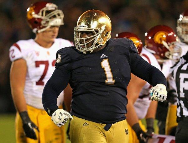 Louis Nix of Notre Dame celebrates near the end of the game against USC earlier this month.