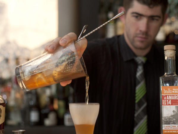 Head bartender Mike Ryan prepares a manhattan with his proprietary amaro at Sable Kitchen & Bar.
