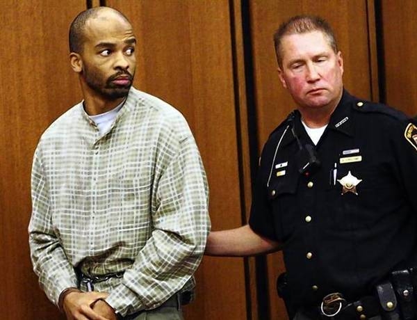 Michael Madison is led out of court after appearing for a pre-trial hearing in Cleveland.