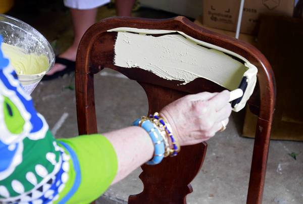 Decorating your rental place can begin by painting furniture in vibrant or fun colors.