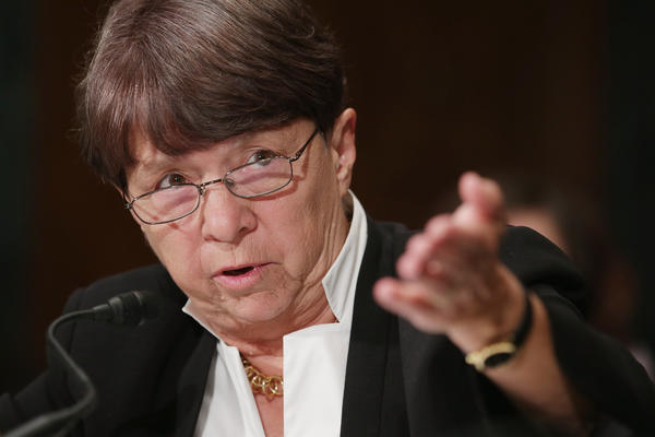 There is no rule at the Securities and Exchange Commission that requires public companies to tell their shareholders what they are up to in partisan elections. Above: SEC chairman Mary Jo White is seen in July.