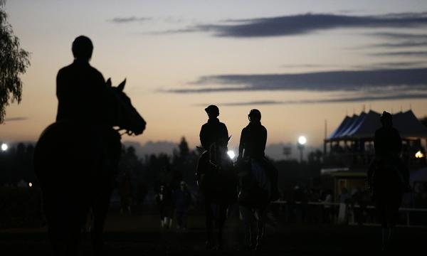 Exercise riders take to the track during a training session at Santa Anita on Tuesday morning.