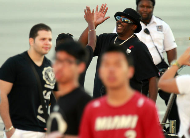 Patrick Rogers Sr. high fives his son Patrick Rogers Jr. outside of the Miami Heat Arena before the season opener.