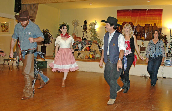 Devin Roth, left, and Art Galvan join the ladies line-dancing at the La Crescenta Woman's Club's Western Round-Up on Saturday night.