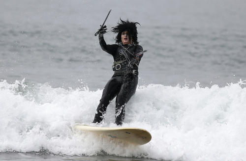 "Heather Blanda, 32, competes dressed as ""Edward Scissorhands"" in the ZJ Boarding House Halloween Surf Contest in Santa Monica, California October 26, 2013."