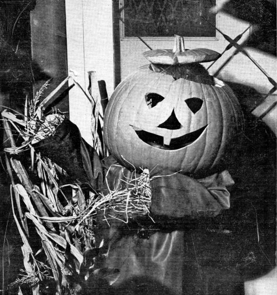 Three-year-old Kiki Merritt dresses as a scarecrow with a jack-o-lantern head to pose for the Halloween 1963 cover of the La Canada Valley Sun.