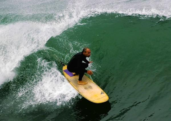 Steve Berger, a 63-year-old surfer from Huntington Beach, competes in the third annual Senior Surf Invitational on Saturday. He competed against his long-time friend Hugh Pierpoint.
