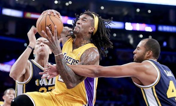 Jordan Hill drives to the basket during a preseason game against the Utah Jazz.