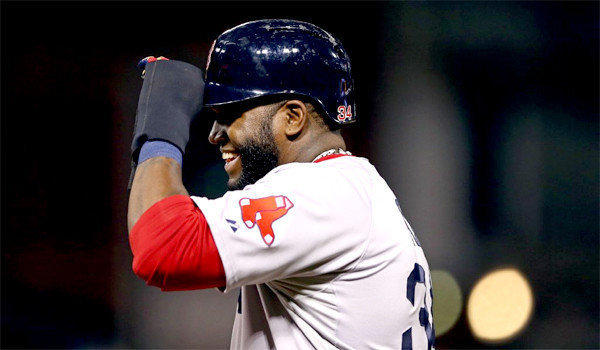 David Ortiz reacts after hitting a single in the eighth inning of the Boston Red Sox's 3-1 victory over the St. Louis Cardinals in Game 5 of the World Series.