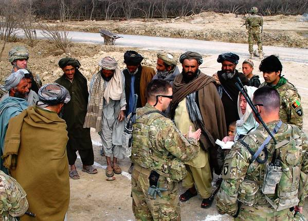 U.S. troops discuss reconstruction plans with tribal leaders from a village in southern Afghanistan's Kandahar province. The village, which was used as a Taliban base, had come under U.S. military bombardment.
