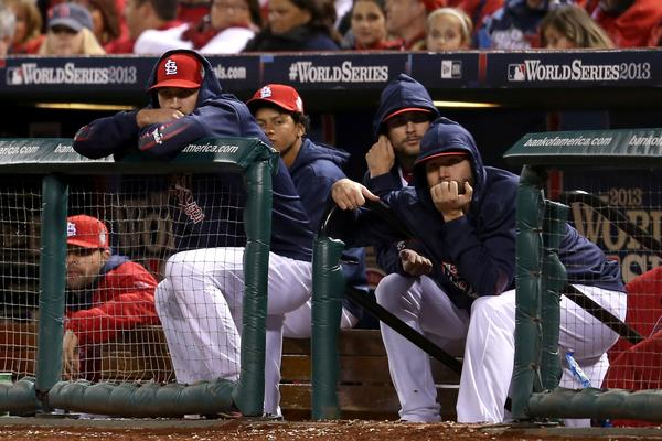 The St. Louis Cardinals look on from their dugout during Game Five of the 2013 World Series against the Boston Red Sox at Busch Stadium on October 28, 2013 in St Louis, Missouri.