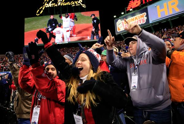 Fans react after David Ortiz #34 of the Boston Red Sox hit a two run home run in the sixth inning against the St. Louis Cardinals during Game 2.