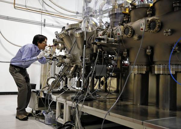 Richard Kodama of Bolingbrook-based EPIR Technologies performs a process, molecular beam epitaxy, that creates a semiconductor used by the military for night-vision technology.
