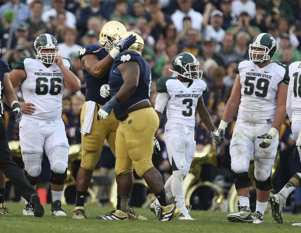 Notre Dame defensive linemen Stephon Tuitt, left, and Louis Nix are likely high NFL draft picks.