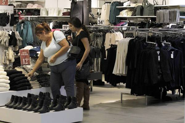 Retailers had a shaky September, as lukewarm back-to-school shopping and a plunge in car purchases caused sales to slide from August, according to the government. Above, shoppers browse a store Tuesday at the Westfield Santa Anita Mall in Arcadia.