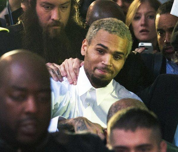 Singer Chris Brown departs the H. Carl Moultrie courthouse on Monday in Washington, D.C. A charge against the Grammy Award-winning R&B singer has been reduced to a misdemeanor, and he was ordered released after his arrest Sunday following an altercation outside a Washington hotel.