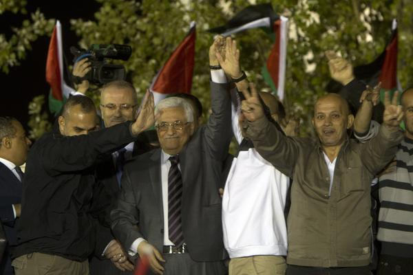 Palestinian Authority President Mahmoud Abbas, wearing tie, greets freed Palestinian prisoners at his headquarters in the West Bank city of Ramallah early Wednesday.