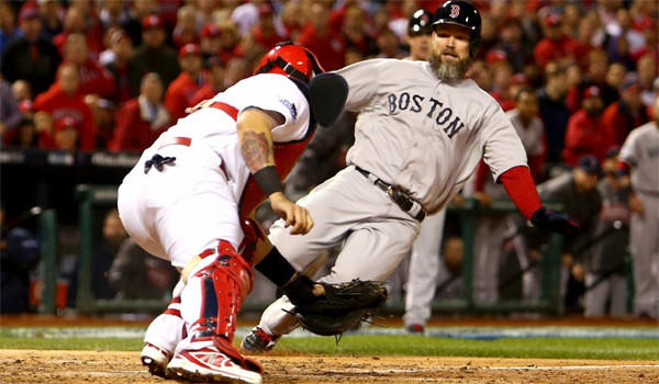 Cardinals catcher Yadier Molina, who won his sixth consecutive Gold Glove award Tuesday, tags out Red Sox catcher David Ross in Game 5 of the World Series at the plate. Boston defeated St. Louis, 3-1, to take a three games to two lead in the series.