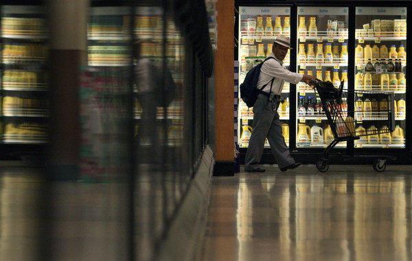 Shopper Atanacio Mandujano scans each aisle while shopping at Ralph's in Los Angeles on August 30, 2013.