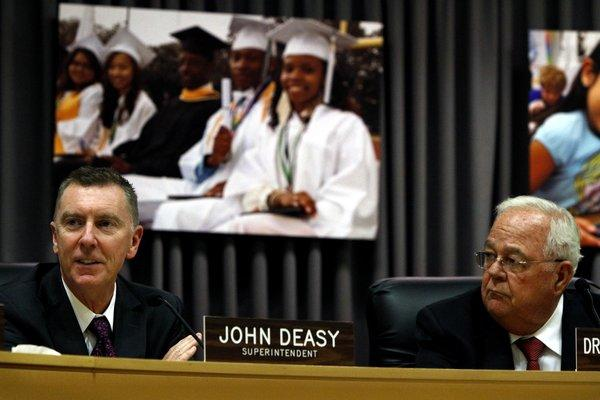 L.A. schools Supt. John Deasy, left, will continue to lead the nation's second-largest school district until 2016, the district's legal counsel announced Tuesday, ending days of rumors that he might resign. Deasy, 52, received a satisfactory evaluation from the Los Angeles Board of Education after a nearly five-hour performance review behind closed doors. He and board President Richard Vladovic, right, make brief remarks after the announcement.