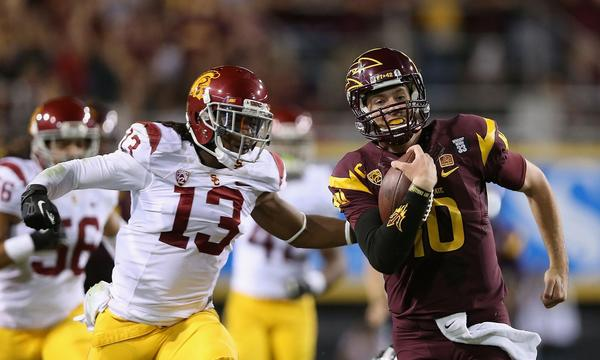 USC cornerback Kevon Seymour, left, chases down Arizona State quarterback Taylor Kelly during a game last month. Seymour expects to see plenty of passes thrown his way against Oregon State on Friday.