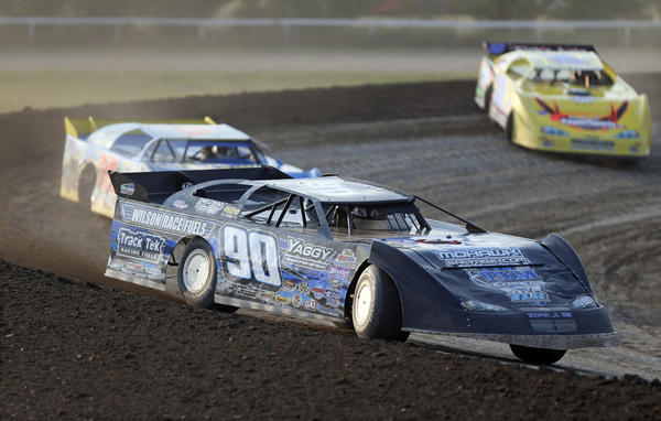 Lance Matthees, of Winona, Mn., (90) leads the field through turn four in their Late Model heat race Aug. 14 night at the Brown County Speedway. American News File Photo by John Davis