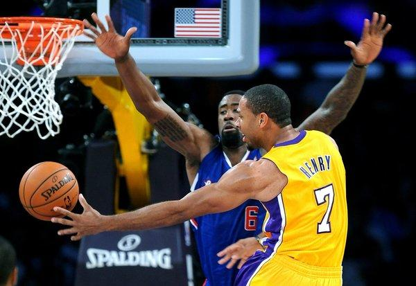 Xavier Henry slips a pass behind DeAndre Jordan during the Lakers' 116-103 home-opening win over the Clippers on Tuesday.