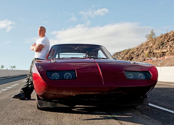 """VIn Diesel and a 1969 Dodge Daytona in a scene from the sixth installment of the real """"Fast and Furious"""" franchise."""