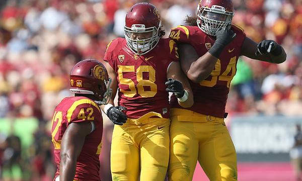 USC lineback J.R. Tavai celebrates with teammate Leonard Williams, right, after sacking Utah quarterback Travis Wilson during Saturday's 19-3 win.