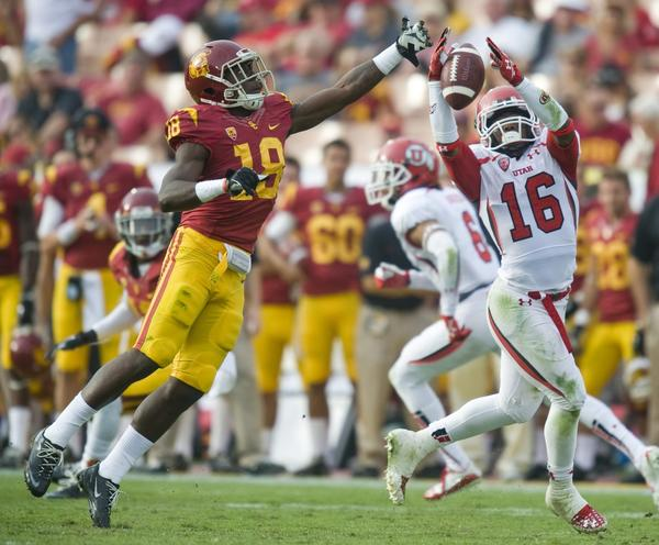 USC safety Dion Bailey, left, breaks up a pass intended for Utah's Geoff Norwood during the second half of the Trojans' 19-3 win Saturday.